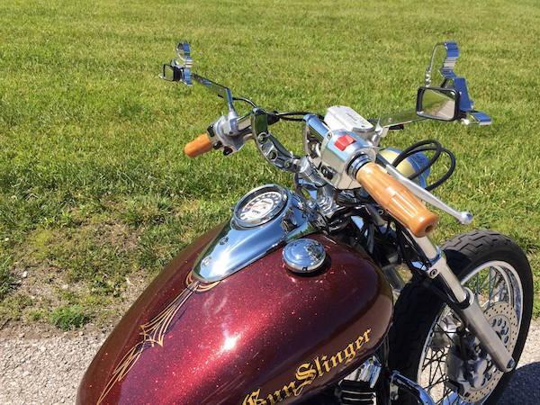 Close up of Gunslinger bike with gold metal flake custom paint.