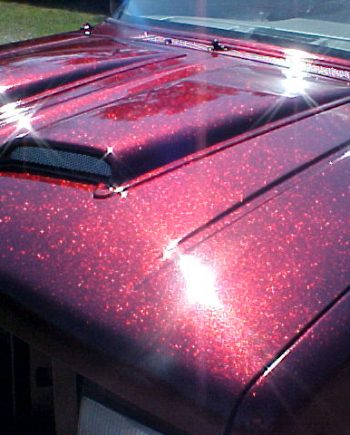 Rose Red Flake paint on hood of Ford Explorer.