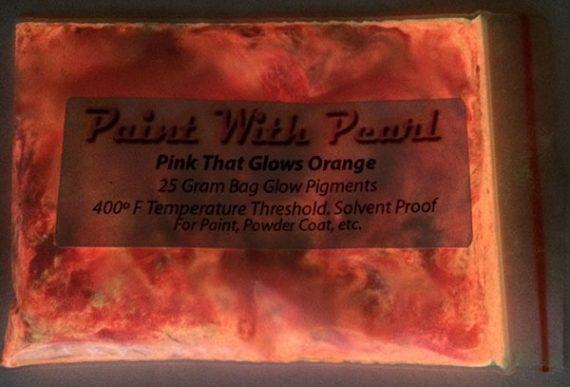 25 Gram Bag of Pink that Glows Orange glowing in the bag.